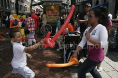 Children have a balloon sword fight in Boston.